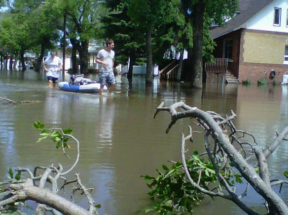 Two Yorkton residents filled up an inflatable boat with clothes from their home and then headed for higher ground. (Dani Mario/CBC)