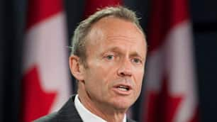 Treasury Board President Stockwell Day says no Canadian should be  barred from a federal job because of race or ethnicity.