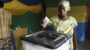 A Rwandan woman casts her vote at a polling station in central  Kigali, Rwanda, on Monday.