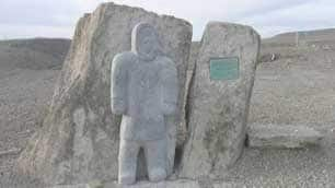 This monument by Resolute, Nunavut, carver Simeonie Amarualik, depicts a man looking out at the Arctic Ocean. A similar sculpture will be unveiled Friday in Grise Fiord.