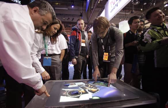 Microsoft's tactile touch screen system is meant to be used on its Surface table-top touch computer, seen here at the Consumer Electronics Show in Las Vegas. (Jae C. Hong/Associated Press)