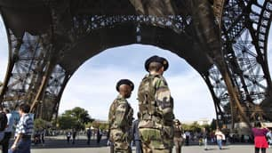 French soldiers under the Eiffel Tower in Paris on Sunday, as the British Foreign Office mentioned France and Germany in a travel advisory about possible militant attacks.