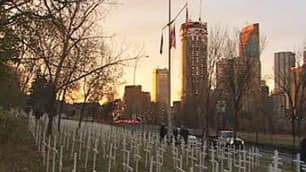 More than 1,400 crosses, each tied to a local member of the Canadian military killed in war, have been set up in a green space along Calgary's Memorial Drive west of the Centre Street Bridge.