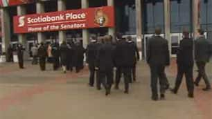 Mourners arrive at Scotiabank Place for the memorial of Ottawa Senators assistant coach Luke Richardson's daughter, Daron.