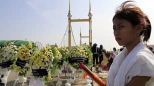 Gneth Srey Keang, 18, the sister of Gneth Srey Neang, who was killed in the bridge stampede on Nov. 22, attends a ceremony Thursday for the victims during a national day of mourning in Phnom Penh.