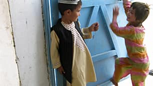 Children play at the entrance to the women's ward at Sarposa prison, where there are 738 prisoners, 14 of them women with 12 children among them in Kandahar, Afghanistan, in 2009.