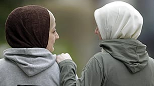 In this picture taken on March 8, two women in Witten, Germany, model hijabs at an Islam-style fashion show.