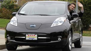Olivier Chalouhi waves from his new electric Nissan Leaf in San Mateo, Calif., Monday. He is the first customer worldwide to receive the all-electric Nissan Leaf.