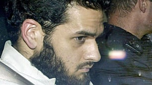 Mohammed Momin Khawaja is seen leaving an Ottawa courthouse under RCMP protection in this May 3, 2004, photo.