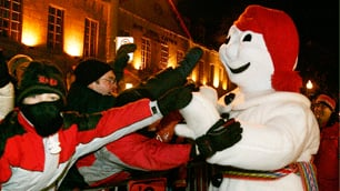 Bonhomme Carnaval greets people during the Quebec Winter Carnival's night parade on Feb. 11, 2006, in Quebec City.