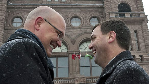 Rocco Rossi, left, is congratulated by Ontario PC Leader Tim Hudak outside the Ontario Provincial Legislature on Tuesday after Hudak announced that Rossi will seek the nomination for the Ontario PC Party in the riding of Toronto's Eglinton-Lawrence.
