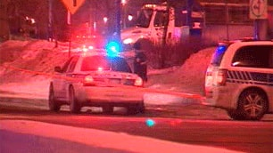 Police officers on the scene early Wednesday morning near Decarie Boulevard and Jean-Talon Street in Montreal