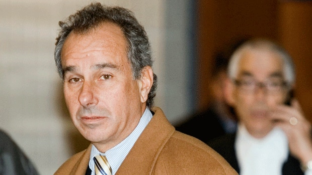 Cinar co-founder Ronald Weinberg arrives at the courthouse in Montreal in 2006. Quebec provincial police have issued arrest warrants for Weinberg and two businessmen in the alleged fraud of $120 million.