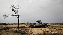 A burned truck is seen on the road leading to the Libyan city of Ajdabiya on Wednesday.