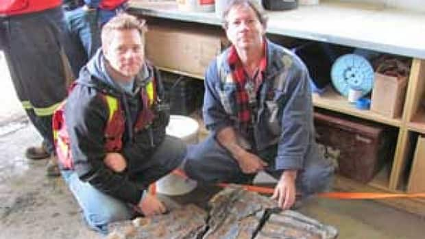 Suncor supervisor Michel Gratton and shovel operator Shawn Funk sent photos of the fossil to the Royal Tyrell Museum.