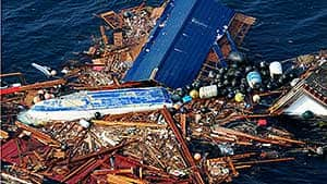 This photo provided by the U.S. Navy shows an aerial view of debris Sunday, March 13, 2011 from an earthquake and subsequent tsunami that struck northern Japan.