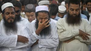 A supporter of the banned extremist Islamist organization Jamaat-ud-Dawa wipes away tears while taking part in a symbolic funeral prayer for late al-Qaeda leader Osama bin Laden in Karachi, Pakistan, on May 3, 2011. Pakistan is one of the few Muslim countries where al-Qaeda still enjoys popular support, writes Brian Stewart.