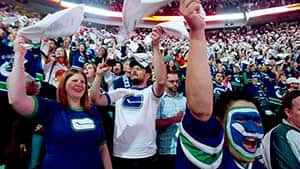 Vancouver Canucks fans wave their white towels during a semifinal playoff game against the San Jose Sharks.
