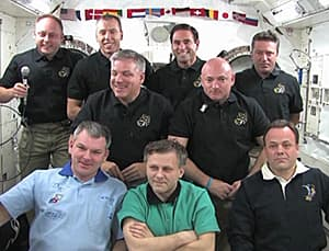 The crews of space shuttle Endeavour and the space station gather for a joint news conference from the station on May 26.