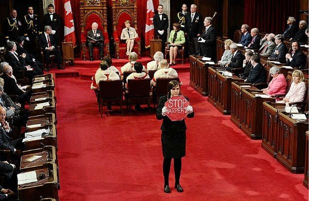 A page stands in the middle of the floor of the Senate as Governor General David Johnston delivers the speech from the throne in the Senate chamber on Parliament Hill on Friday.