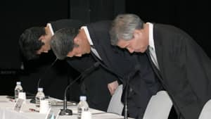 Sony CEO Kazuo Hirai, centre, bows in apology along with two other executives in Tokyo on May 1 regarding a security breach in April.