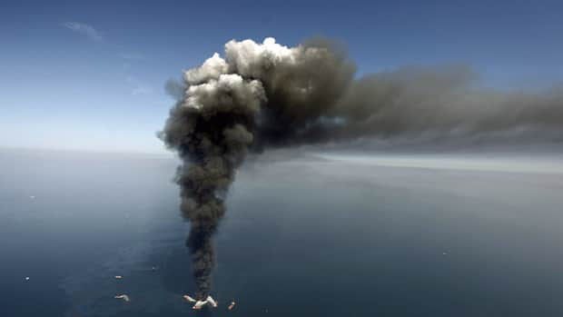 Smoke rises from fires on the Deepwater Horizon offshore oil rig on April 21, 2010, a day after an explosion at the offshore platform killed 11 men and began spilling 780 million litres of petroleum into the Gulf of Mexico.