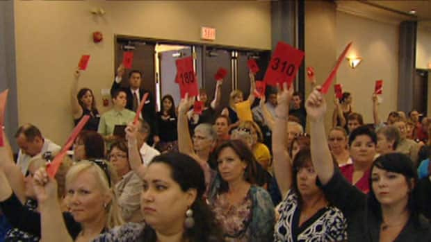Members of the United Way Ottawa vote on a review at a general meeting Tuesday evening.
