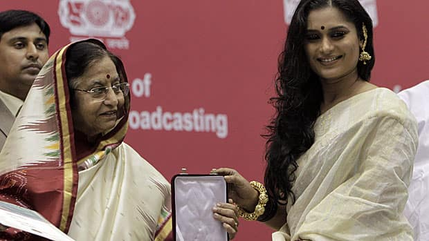 While the IIFA awards, in Toronto June 23-25, celebrate Hindi-language films, the National Film Awards recognize films in India's many languages. Indian actress Ananya Chatterjee, right, accepts the award for best actress from Indian President Pratibha Patil during the 57th NFA ceremony, in New Delhi, India, on Oct. 22, 2010. Chatterjee received the award for her role in the Bengali film Abohomaan.