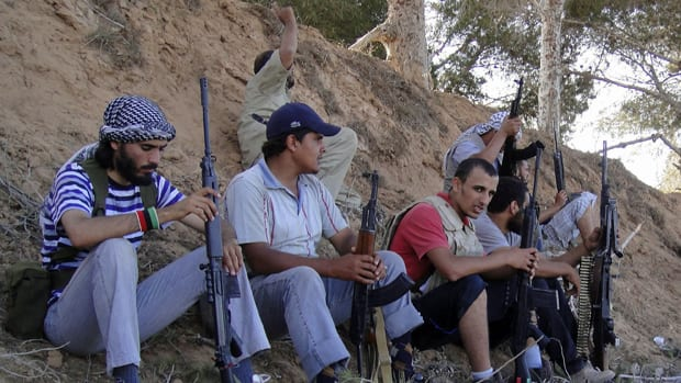 Libyan rebels rest after a heavy fight with pro-Moammar Gadhafi forces. The rebels say they are engaging in fierce clashes with government fighters southwest of the capital of Tripoli.