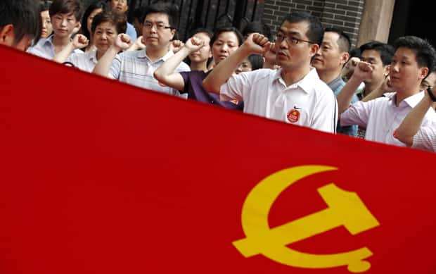 Party members swear the oath in front of a Chinese Communist Party flag at the Site of the First National Congress of the Communist Party of China,  Friday in Shanghai, China.