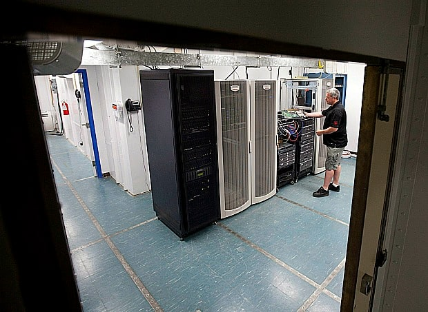 Internet company Koallo owner Stuart Hodge looks over some of his servers in a secure room in Carp, Ont. on July 13, 2011.