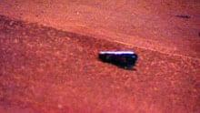 A gun lies on a sidewalk at Greber Boulevard after a shooting at a Gatineau strip club.
