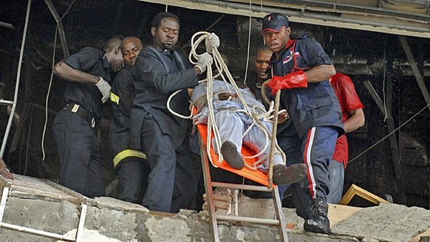 A injured man is carried from a United Nation's office after a car blew up in Abuja, Nigeria on Friday.