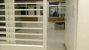 Double-bunking, where two prisoners are put in cells designed for one, is a practice that won't end soon, Corrections Minister Christine Tell says.