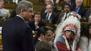 Then-Assembly of First Nations Chief Phil Fontaine watches as Prime Minister Stephen Harper officially apologizes for loss caused by the Indian residential school system on Parliament Hill in Ottawa in June, 2008
