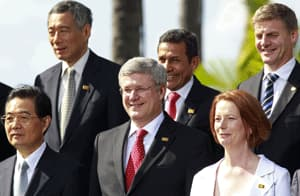 Stephen Harper stands with leaders of some of the countires that make up the Trans-Pacific Partnership at the APEC summit in Honolulu, including Singapore, Peru, New Zealand and Australia. China, represented here by President Hu Jintao, bottom left, is not part of the TPP.