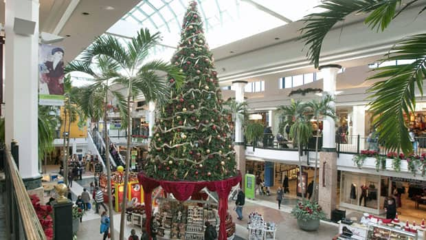 Shoppers walk to stores at the Laurier shopping centre in Quebec City in December 2010. A survey suggests that despite an increase in cross-border shopping, Canadian retail sales this holiday season should rise by between two and three per cent from last year. Jacques Boissinot/Canadian Press