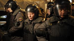 Police officers block the way during a protest against alleged vote rigging in Russia's parliamentary elections in Triumphal Square in Moscow, Russia, late Wednesday, Dec. 7, 2011.