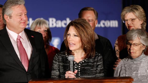 Rep. Michele Bachmann, R-Minn.,  joined by husband Marcus, left, family and friends, announces that she will end her campaign for president, on Wednesday in West Des Moines, Iowa.