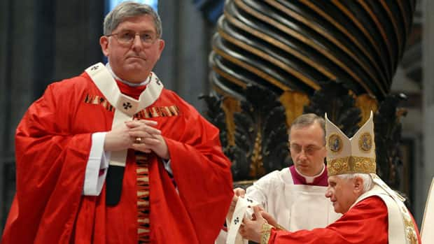 Archbishop of Toronto Thomas Christopher Collins walks away after receiving a garment from Pope Benedict XVI during a ceremony inside St. Peter's Basilica at the Vatican in 2007. On Friday, the Pope named Collins as one of 22 new cardinals.