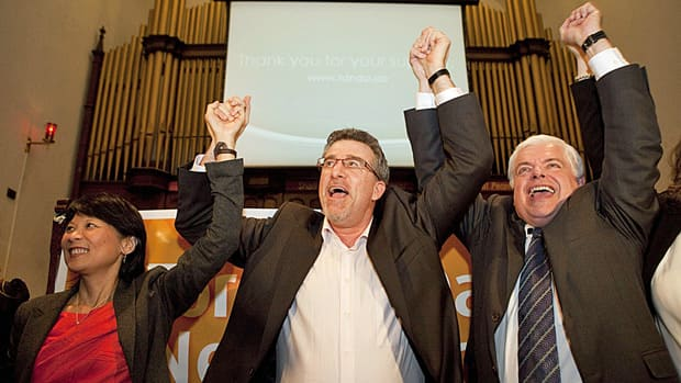 Craig Scott, centre, celebrates with Trinity-Spadina MP Olivia Chow and MPP Peter Tabuns, rght, after winning the nomination on Monday to run for the NDP in the riding of Toronto-Danforth.