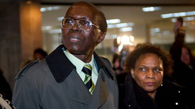 Léon Mugesera, accused of helping incite the Rwandan genocide, arrives with his wife Jemma at Federal Court in Montreal this week.