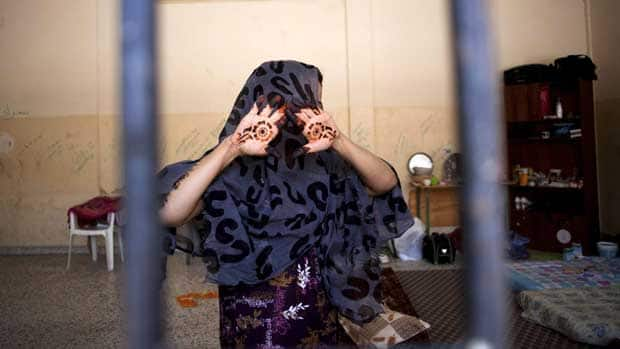 In this Sept. 22, 2011 file photo, a woman suspected of being a Gadhafi loyalist is seen behind bars inside a detention facility in Misrata, Libya.