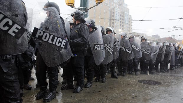 During the 'kettling' incident on the final evening of the G20 summit, lines of riot police boxed in hundreds of people at an intersection in downtown Toronto and held them there for up to four hours while it poured rain.