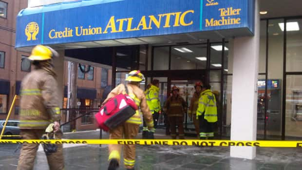 Fire crews work outside the Credit Union.
