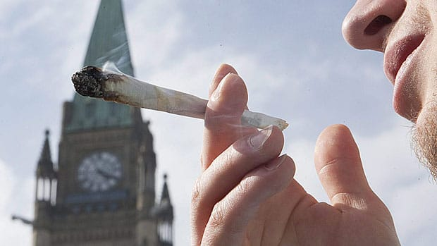 A demonstrator smokes a marijuana cigarette on Parliament Hill in 2010. An international panel that includes a one-time Supreme Court judge and the former leaders of Brazil and Switzerland are calling on Prime Minister Stephen Harper to stop what they call the destructive, expensive and ineffective war on drugs.