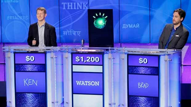 Jeopardy! contestants Ken Jennings, left, and Brad Rutter, right, look on as the IBM computer Watson beats them to the buzzer to answer questions. Citigroup and IBM want to use Watson to improve banking.
