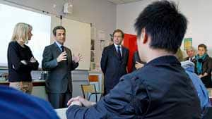 France's President Nicolas Sarkozy, second from left, speaks with students at the Francois Couperin College in Paris Tuesday, the day after a gunman killed four victims at a Jewish school in Toulouse. With him is Education Minister Luc Chatel.