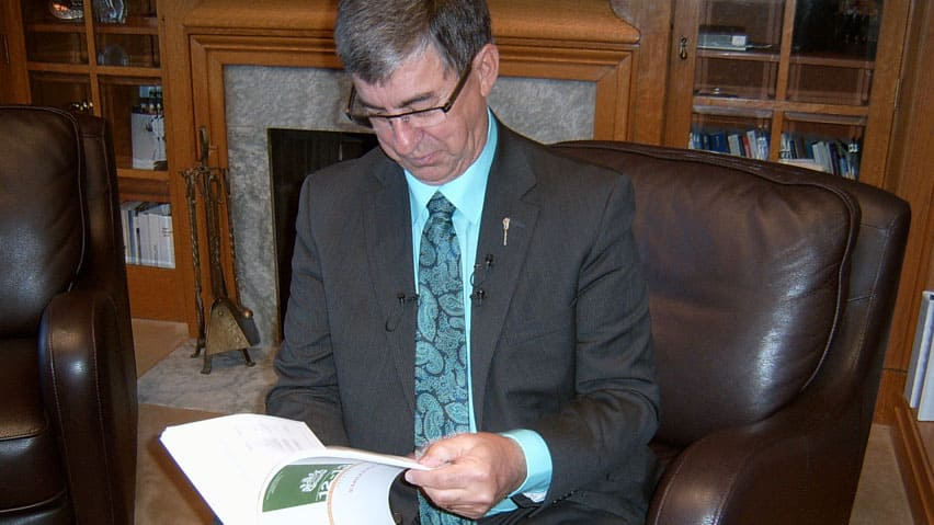 Finance Minister Ken Kravetz was all smiles as he prepared to unveil his provincial budget.