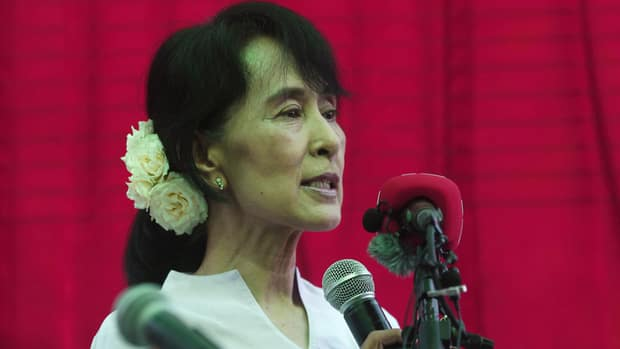 Burmese pro-democracy leader Aung San Suu Kyi talks to reporters during a news conference in her home in Rangoon on March 30.